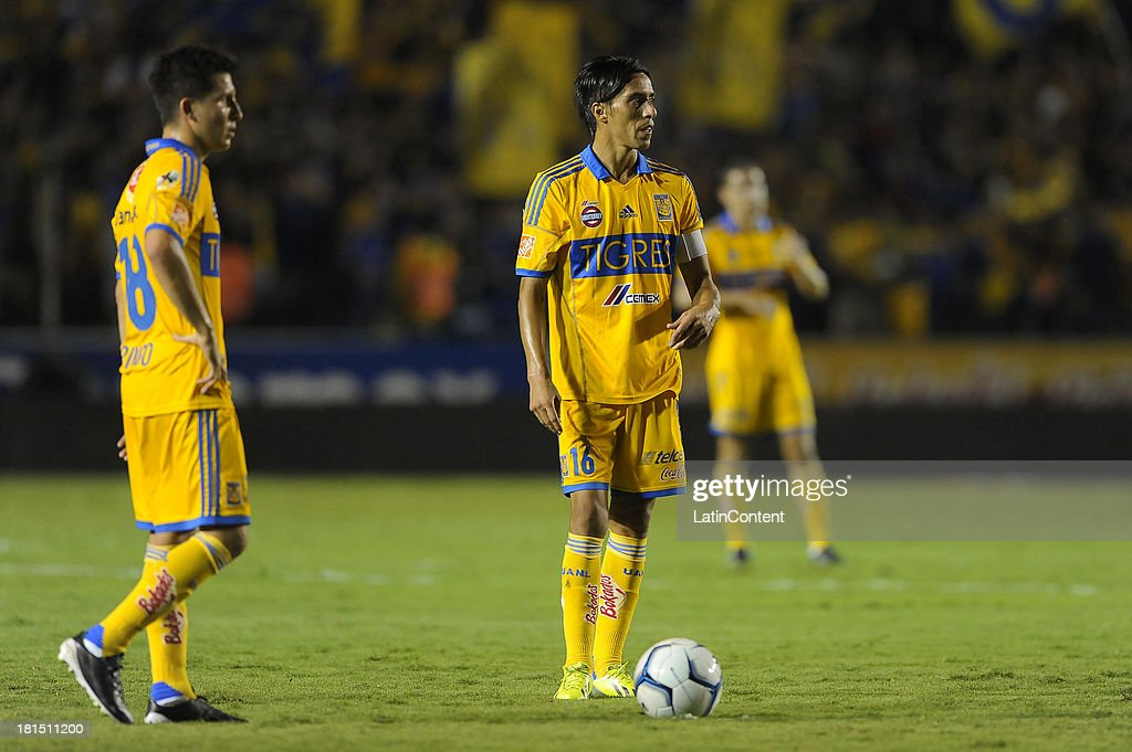 José Torres and Lucas Lobos of Tigres in action during a match between Tigres UANL and Puebla FC as part of the Liga MX at Universitario stadium on September 21, 2013 in Monterrey, Mexico.