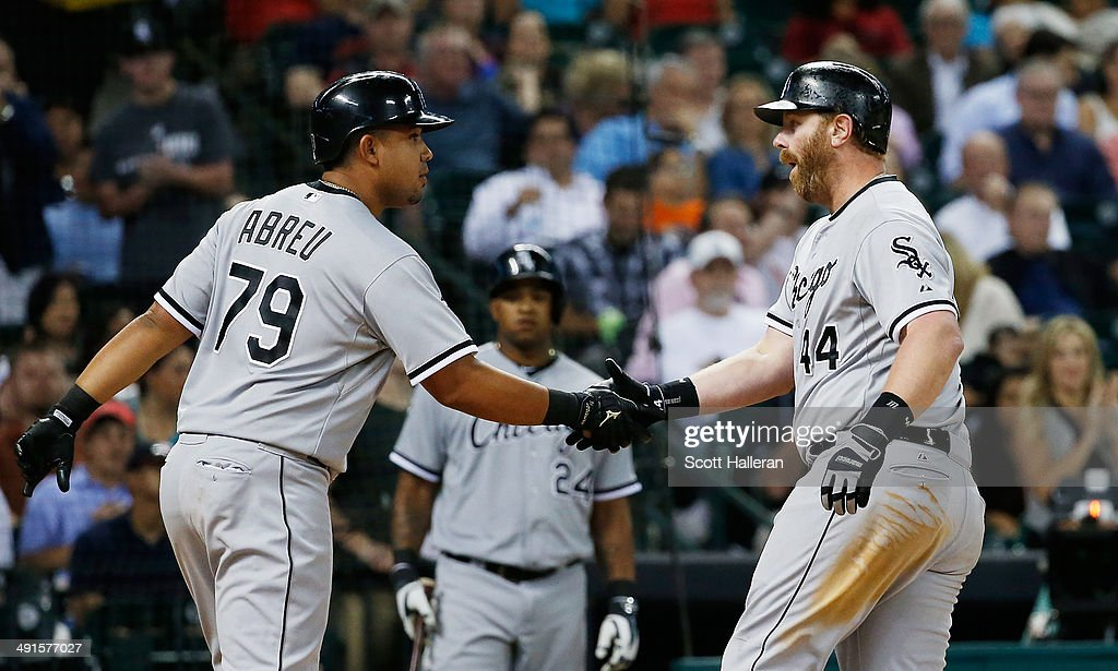 Jose Abreu #79 and <a gi-track='captionPersonalityLinkClicked' href=/galleries/search?phrase=Adam+Dunn&family=editorial&specificpeople=213505 ng-click='$event.stopPropagation()'>Adam Dunn</a> #44 of the Chicago White Sox celebrate at the plate after Dunn hiit a three-run home run to right field in the sixth inning of their game against the Houston Astros at Minute Maid Park on May 16, 2014 in Houston, Texas.