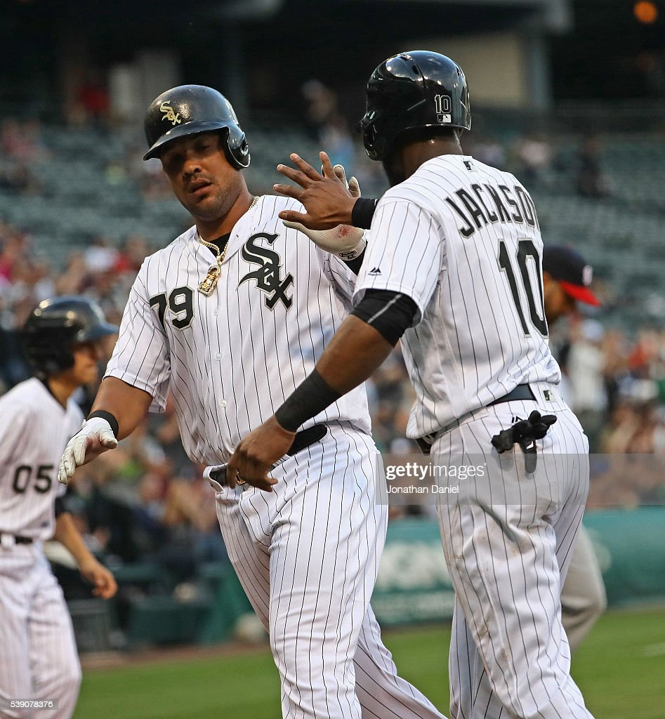 Jose Abreu and Austin Jackson of the Chicago White Sox celebrate after scoring runs in the 1st inning against the Washington Nationals at US Cellular...