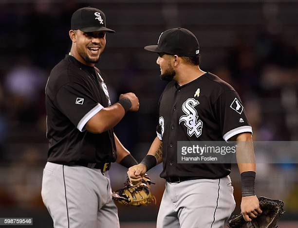 Jose Abreu and Melky Cabrera of the Chicago White Sox celebrate winning the game against the Minnesota Twins on September 2 2016 at Target Field in...