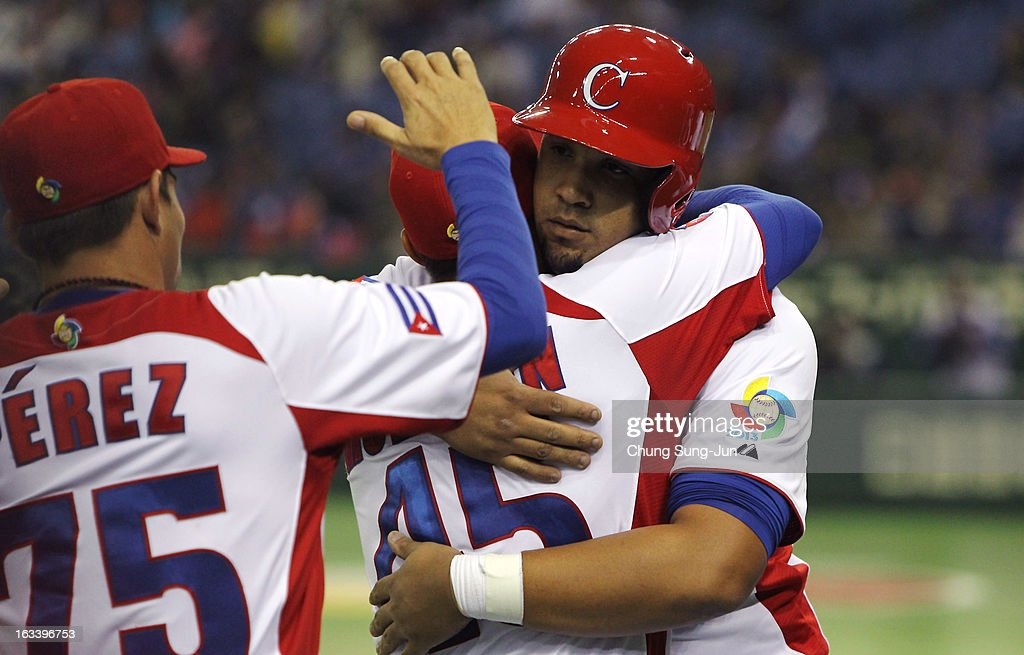 Jose Abreu # 79 celebrates with Frank Morejon # 45 after two run home run in the sixth inning during the World Baseball Classic Second Round Pool 1 game between Chinese Taipei and Cuba at Tokyo Dome on March 9, 2013 in Tokyo, Japan.