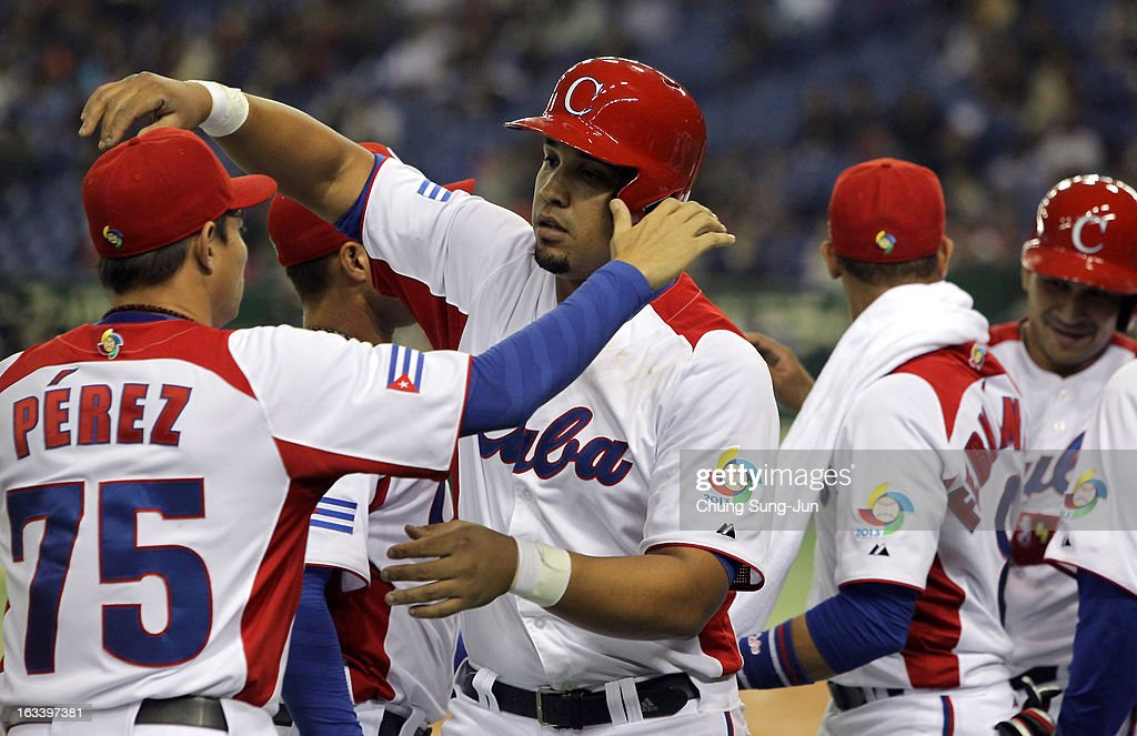 Jose Abreu # 79 celebrates with Wilber Perez # 75 of Cuba after two run home run in the sixth inning during the World Baseball Classic Second Round Pool 1 game between Chinese Taipei and Cuba at Tokyo Dome on March 9, 2013 in Tokyo, Japan.