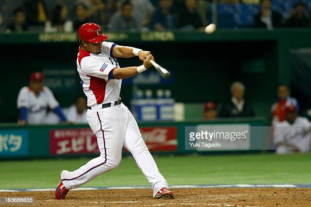 Jose Abreu of Team Cuba hits a two run home run in the bottom of the sixth inning during Pool 1 Game 3 between the Chinese Taipei and Cuba in the...