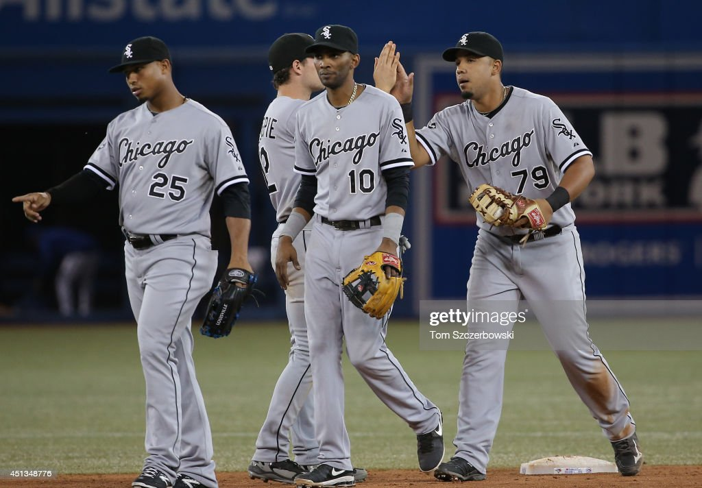 Jose Abreu #79 of the Chicago White Sox and Alexei Ramirez #10 celebrate their victory with Conor Gillaspie #12 during MLB game action against the Toronto Blue Jays on June 27, 2014 at Rogers Centre in Toronto, Ontario, Canada.
