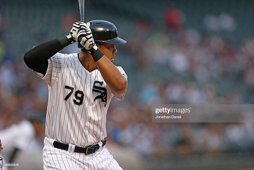 Jose Abreu of the Chicago White Sox bats against the Texas Rangers at US Cellular Field on August 5 2014 in Chicago Illinois The Rangers defeated the...
