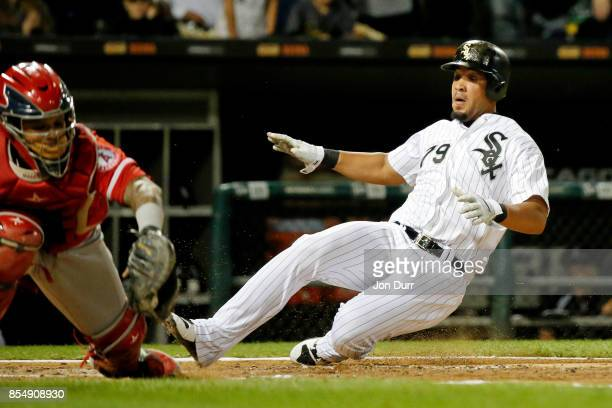 Jose Abreu of the Chicago White Sox beats the tag of Martin Maldonado of the Los Angeles Angels of Anaheim to score on an RBI double by Nicky...