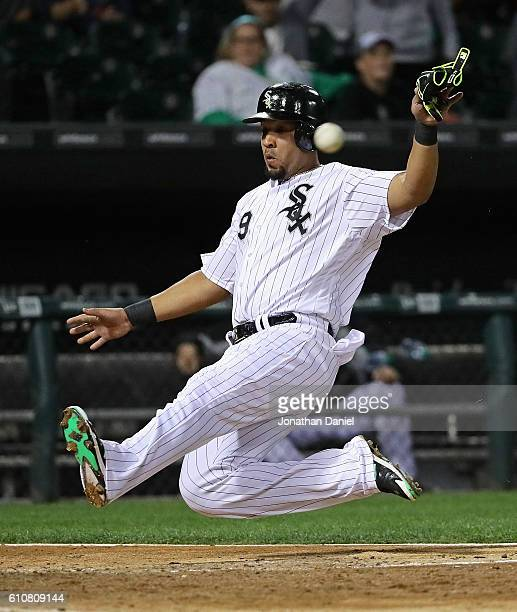 Jose Abreu of the Chicago White Sox beats the throw to score a run in the 8th inning against the Tampa Bay Rays at US Cellular Field on September 27...