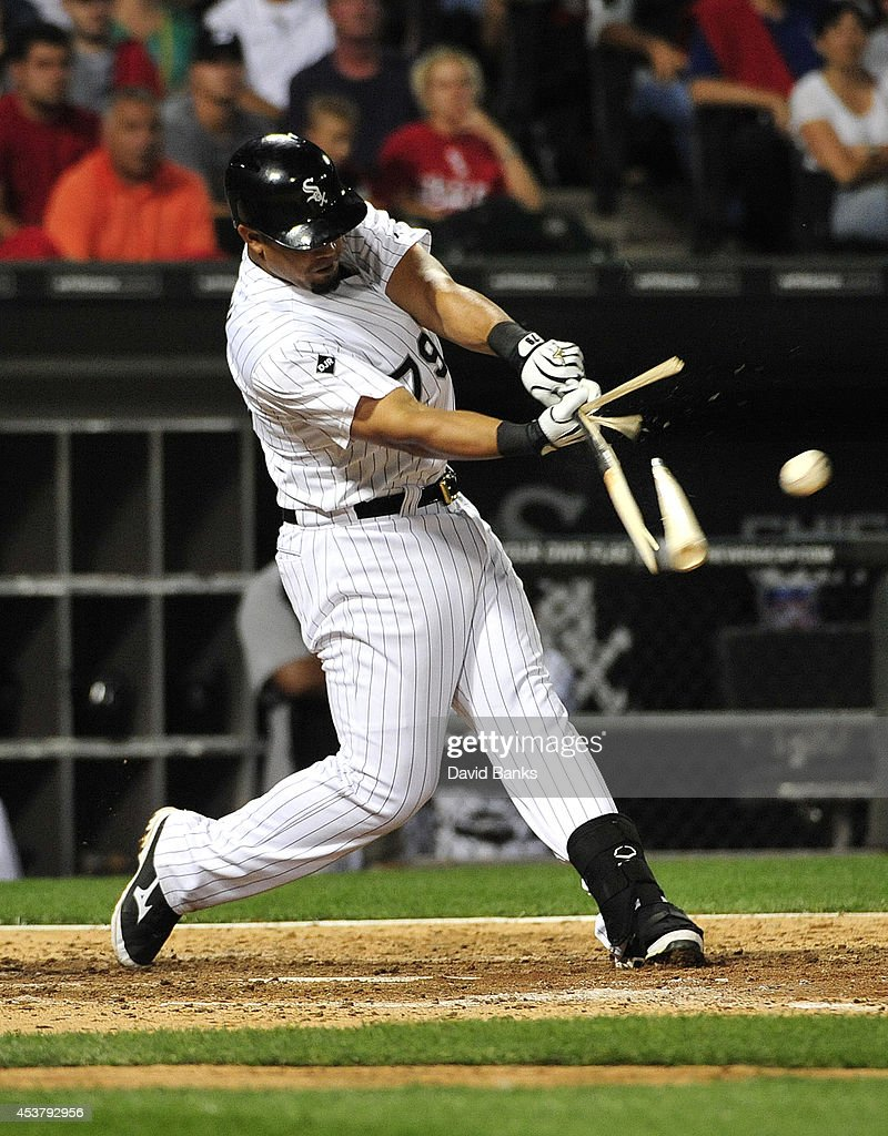 Jose Abreu #79 of the Chicago White Sox breaks his bat against the Baltimore Orioles during the seventh inning on August 18, 2014 at U. S. Cellular Field in Chicago, Illinois.