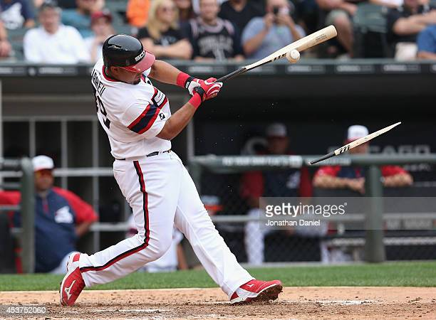 Jose Abreu of the Chicago White Sox breaks his bat hitting against the Toronto Blue Jays at US Cellular Field on August 17 2014 in Chicago Illinois...
