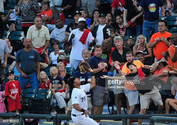 Jose Abreu of the Chicago White Sox catches a foul ball hit by Caleb Joseph of the Baltimore Orioles during the second inning on August 18 2014 at U...
