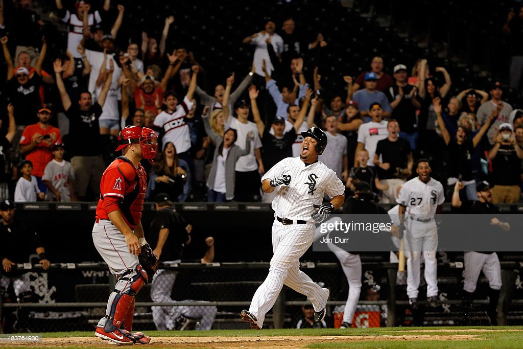 Jose Abreu of the Chicago White Sox celebrates as he scores the game winning run off of a one run RBI double by Avisail Garcia at US Cellular Field...