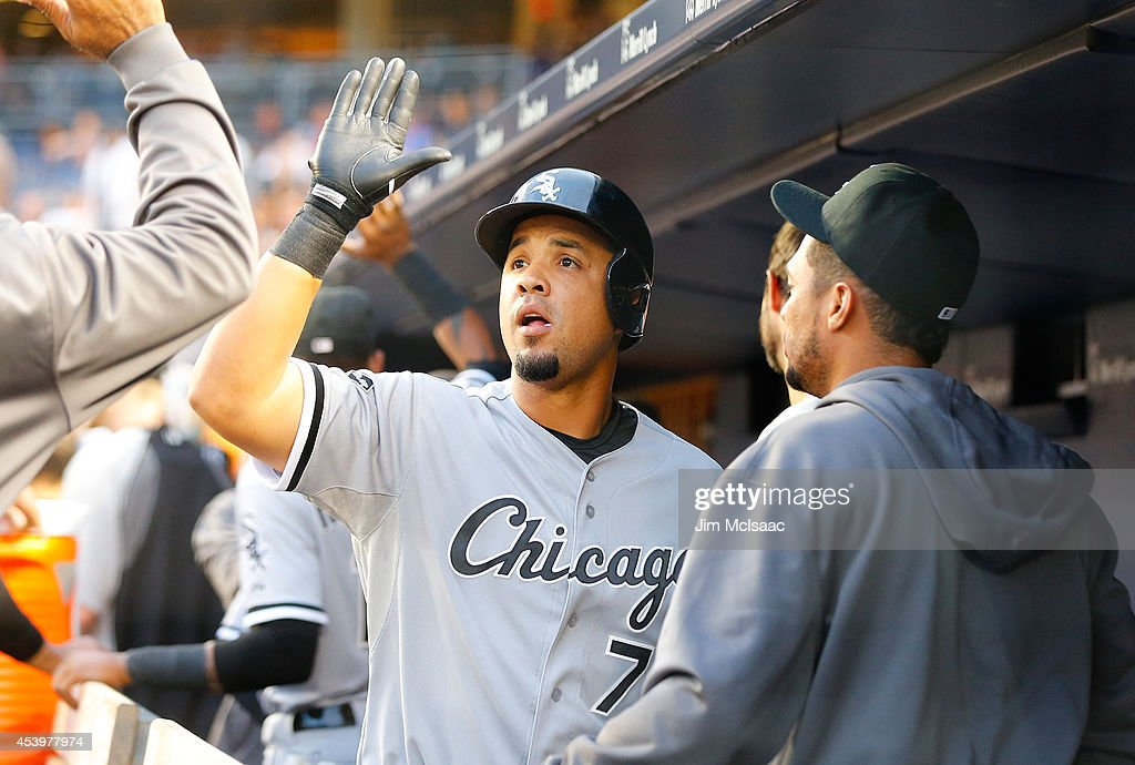 Jose Abreu of the Chicago White Sox celebrates his first inning three run home run against the New York Yankees at Yankee Stadium on August 22 2014...