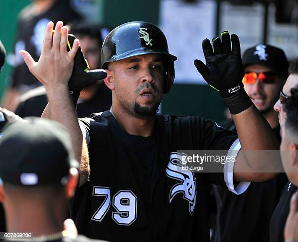 Jose Abreu of the Chicago White Sox celebrates his home run with teammates in the fourth inning against the Kansas City Royals at Kauffman Stadium on...