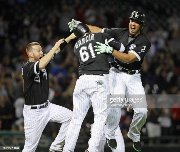 Jose Abreu of the Chicago White Sox celebrates his two run game winning double in the 9th inning with Willy Garcia and Todd Frazier against the New...