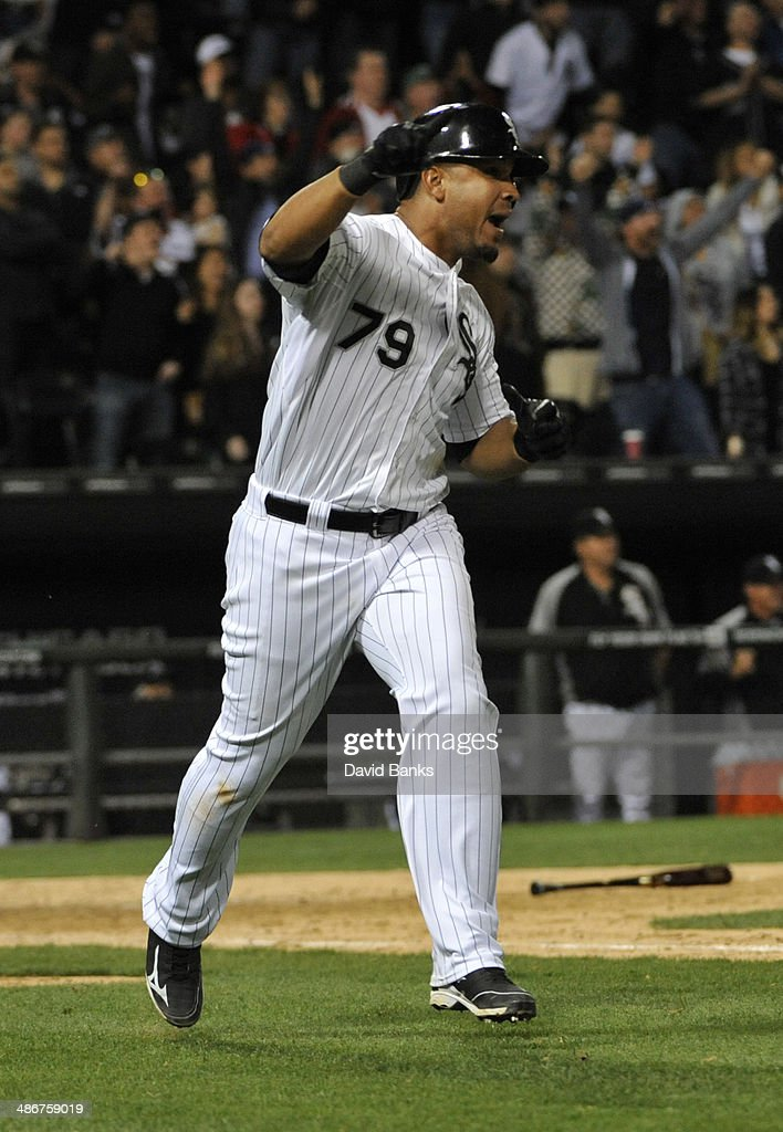 Jose Abreu of the Chicago White Sox celebrates his walkoff grand slam homer against the Tampa Bay Rays during the ninth inning on April 25 2014 at US...