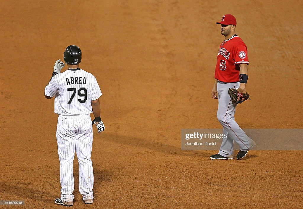 Jose Abreu #79 of the Chicago White Sox chats with <a gi-track='captionPersonalityLinkClicked' href=/galleries/search?phrase=Albert+Pujols&family=editorial&specificpeople=171151 ng-click='$event.stopPropagation()'>Albert Pujols</a> #5 of the Los Angeles Angels of Anaheim as he stands at first base at U.S. Cellular Field on July 2, 2014 in Chicago, Illinois. The White Sox defeated the Angels 3-2.