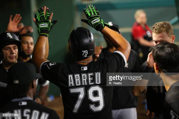 Jose Abreu of the Chicago White Sox congratulated for scoring in the seventh inning against the Texas Rangers at Globe Life Park in Arlington on...