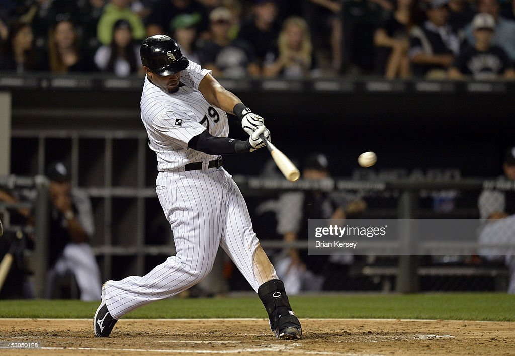 Jose Abreu #79 of the Chicago White Sox connects on an RBI single scoring Adam Eaton during the fourth inning against the Minnesota Twins at U.S. Cellular Field on August 1, 2014 in Chicago, Illinois.