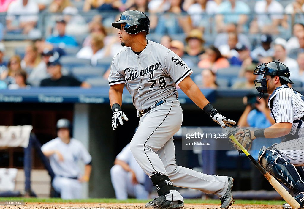 Jose Abreu #79 of the Chicago White Sox follows through on a third inning base hit against the New York Yankees at Yankee Stadium on August 24, 2014 in the Bronx borough of New York City. The Yankees defeated the White Sox 7-4 in ten innings.