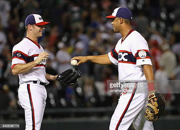 Jose Abreu of the Chicago White Sox gives the last out ball to David Robertson after w in against the Detroit Tigers at US Cellular Field on June 15...