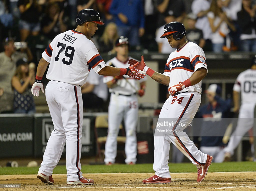 Jose Abreu #79 of the Chicago White Sox greets teammate Dayan Viciedo #24 at home plate after Viciedo hit a two-run home run scoring Abreu during the sixth inning against the Houston Astros at U.S. Cellular Field on July 18, 2014 in Chicago, Illinois.