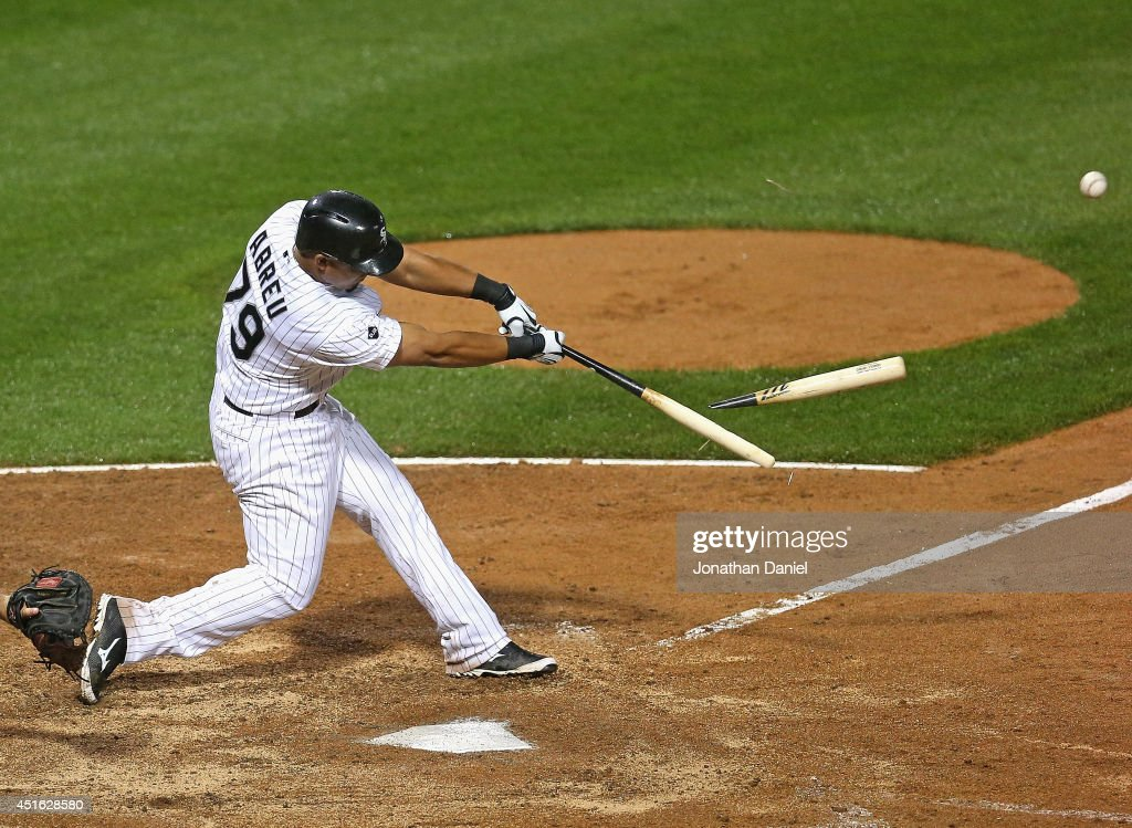 Jose Abreu of the Chicago White Sox hits a broken bat single in the 8th inning against the Los Angeles Angels of Anaheim at US Cellular Field on July...