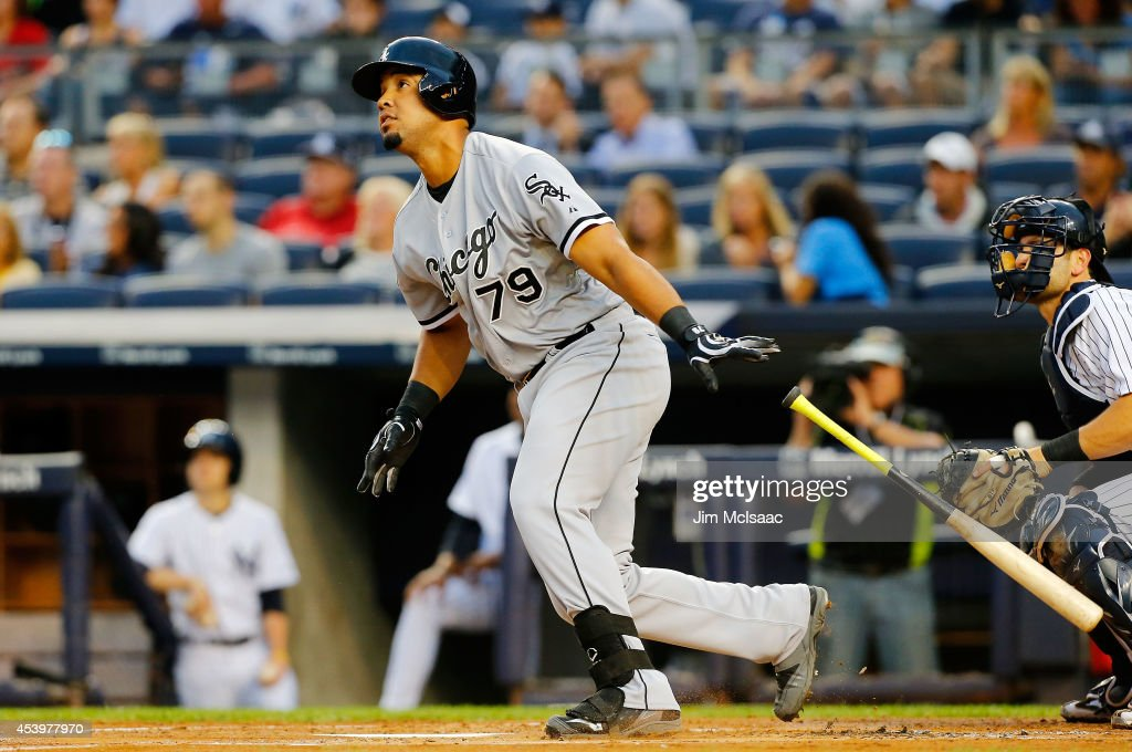 Jose Abreu of the Chicago White Sox hits a first inning three run home run against the New York Yankees at Yankee Stadium on August 22 2014 in the...