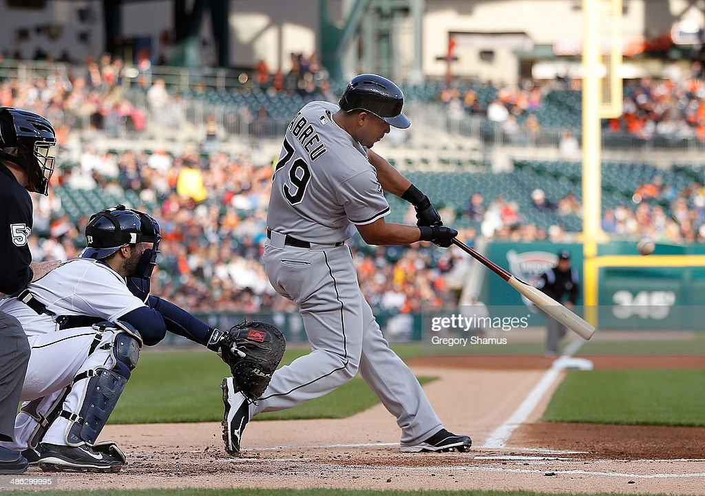 Jose Abreu of the Chicago White Sox hits a first inning two run home run in front of Alex Avila of the Detroit Tigers at Comerica Park on April 23...