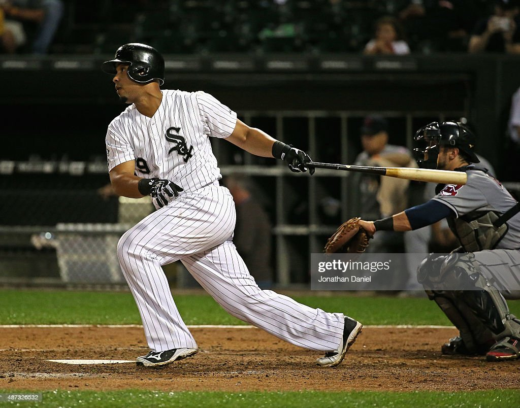 Jose Abreu of the Chicago White Sox hits a run scoring single in the 5th inning against the Cleveland Indians at US Cellular Field on September 8...