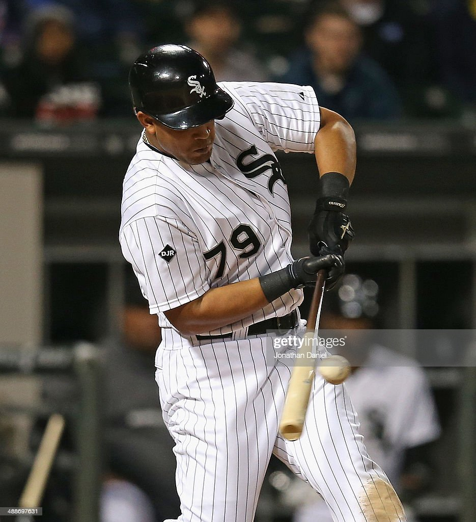 Jose Abreu #79 of the Chicago White Sox hits a single in the 5th inning against the Chicago Cubs at U.S. Cellular Field on May 7, 2014 in Chicago, Illinois.