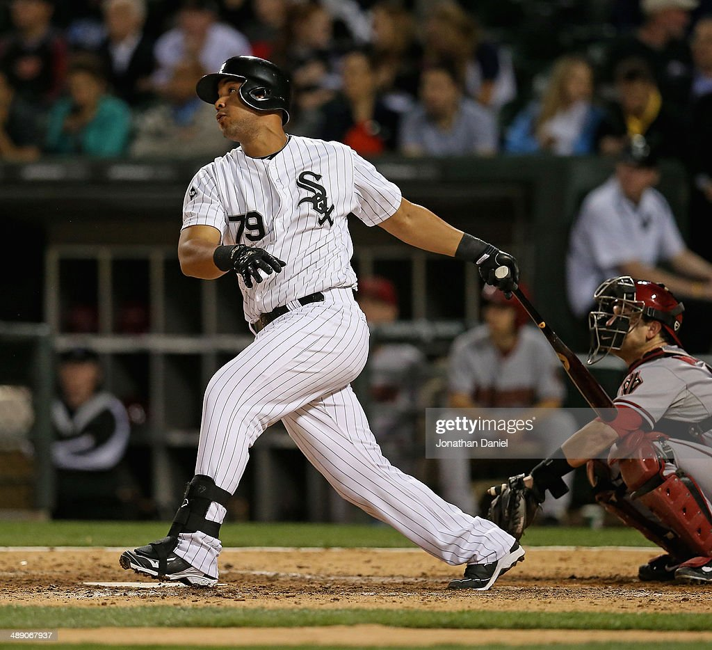 Jose Abreu #79 of the Chicago White Sox hits a solo home run in the 7th inning against the Arizona Diamondbacks at U.S. Cellular Field on May 9, 2014 in Chicago, Illinois.
