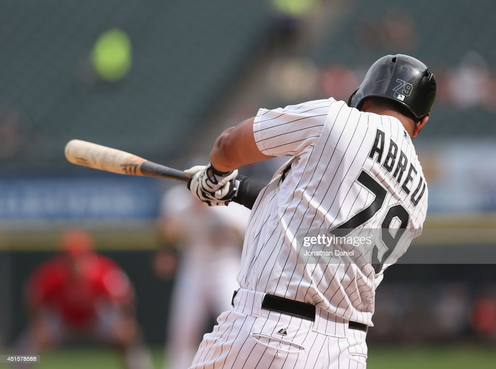 Jose Abreu #79 of the Chicago White Sox hits a three-run home run in the 1st inning against the Los Angeles Angels of Anaheim at U.S. Cellular Field on July 1, 2014 in Chicago, Illinois.