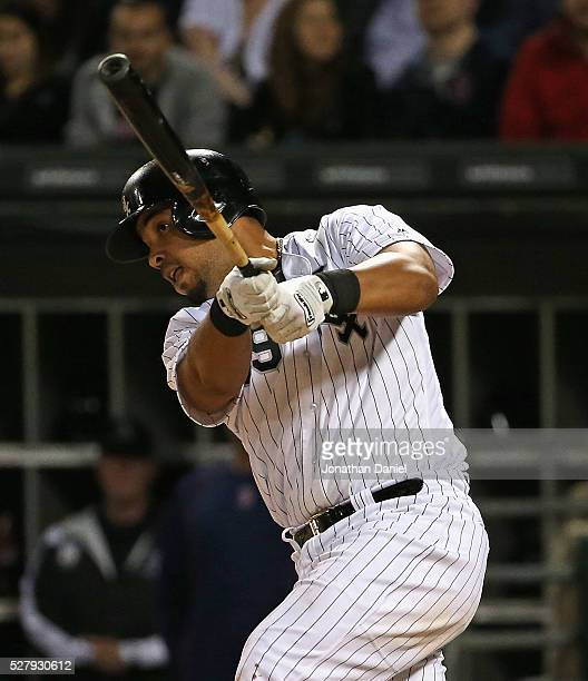 Jose Abreu of the Chicago White Sox hits a two run double in the 8th inning against the Boston Red Sox at US Cellular Field on May 3 2016 in Chicago...