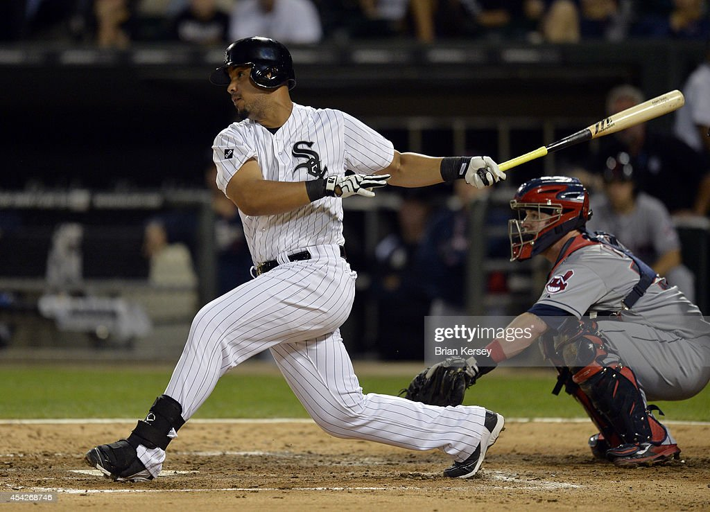 Jose Abreu of the Chicago White Sox hits an RBI single scoring teammate Adam Eaton during the third inning against the Cleveland Indians at US...