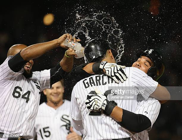 Jose Abreu of the Chicago White Sox hugs Avisail Garcia after Garcia was hit by a pitch to walk in the winning run against the Detroit Tigers as...