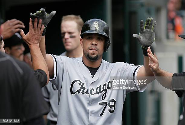 Jose Abreu of the Chicago White Sox is congratulated after hitting a home run against the Detroit Tigers during the fourth inning at Comerica Park on...