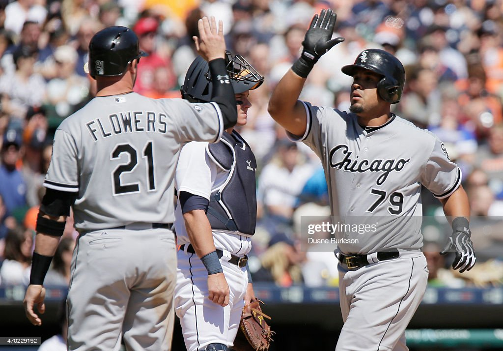 Jose Abreu #79 of the Chicago White Sox is congratulated by <a gi-track='captionPersonalityLinkClicked' href=/galleries/search?phrase=Tyler+Flowers&family=editorial&specificpeople=4217244 ng-click='$event.stopPropagation()'>Tyler Flowers</a> #21 of the Chicago White Sox after hitting a grand slam against the Detroit Tigers during the fourth inning at Comerica Park on April 18, 2015 in Detroit, Michigan.
