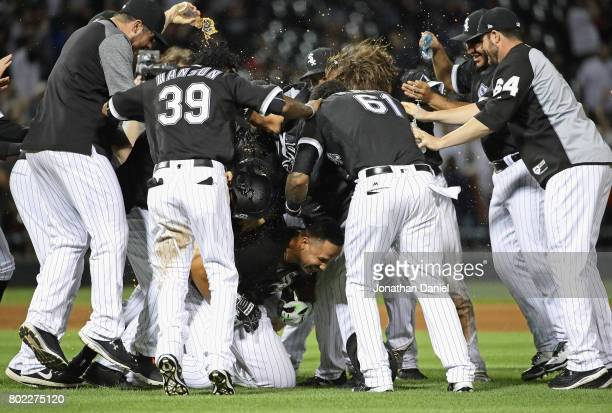 Jose Abreu of the Chicago White Sox is mobbed by teammates after hitting a two run game winning double in the 9th inning against the New York Yankees...