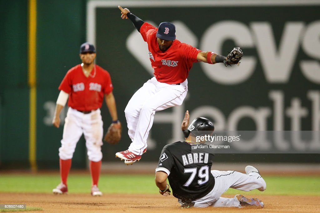 Jose Abreu #79 of the Chicago White Sox is out at second base as Eduardo Nunez #36 of the Boston Red Sox jumps over his slide in the eighth inning of a game at Fenway Park on August 4, 2017 in Boston, Massachusetts.