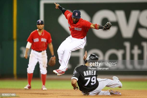 Jose Abreu of the Chicago White Sox is out at second base as Eduardo Nunez of the Boston Red Sox jumps over his slide in the eighth inning of a game...