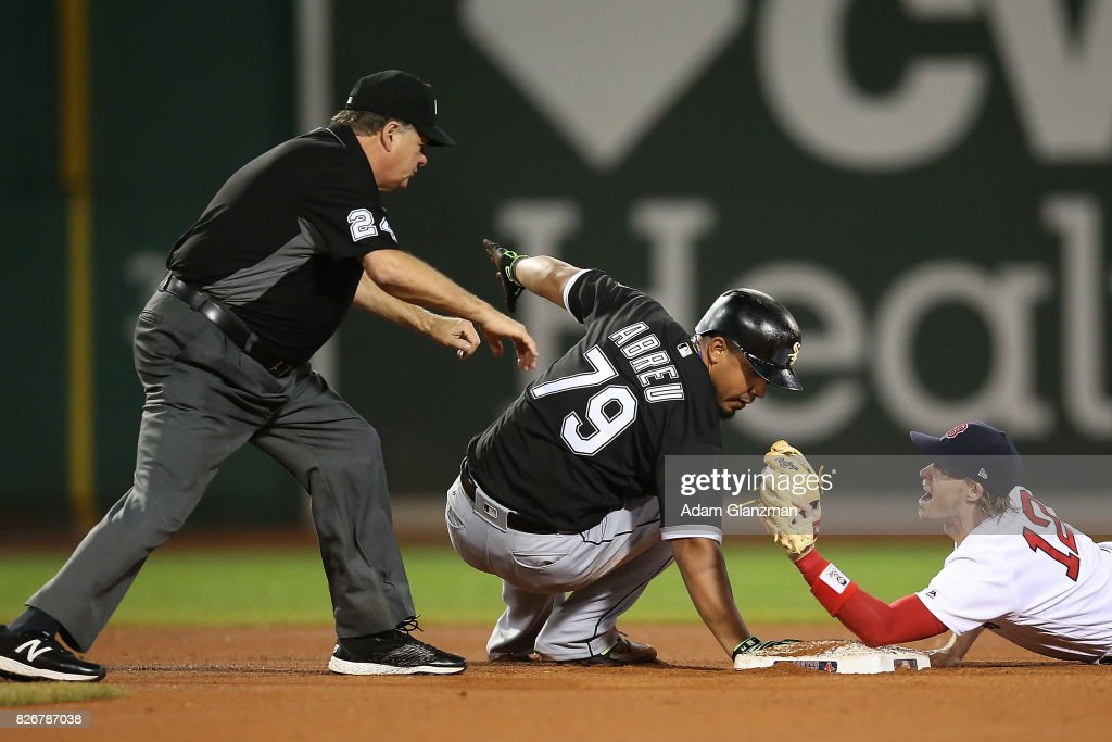 Jose Abreu #79 of the Chicago White Sox is safe at second base after dodging the tag of Brock Holt #12 of the Boston Red Sox in the eighth inning of a game at Fenway Park on August 5, 2017 in Boston, Massachusetts. The call was later overturned.