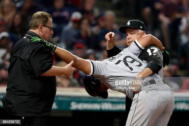 Jose Abreu of the Chicago White Sox is tended to by medical staff after being hit by a pitch in the seventh inning against the Cleveland Indians at...