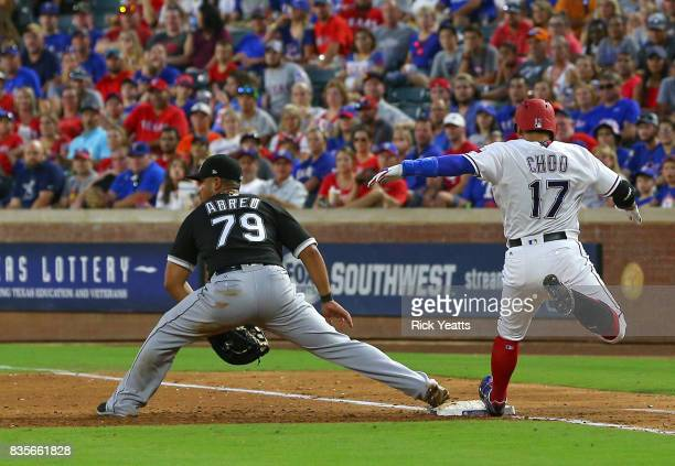 Jose Abreu of the Chicago White Sox misses the tag on ShinSoo Choo of the Texas Rangers in the third inning at Globe Life Park in Arlington on August...