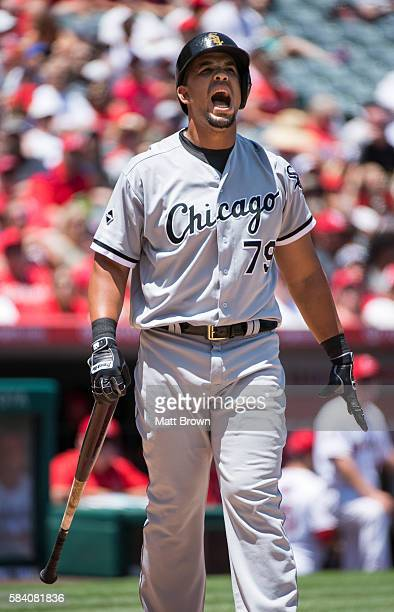 Jose Abreu of the Chicago White Sox reacts after a foul tip during the third inning of the game against the Los Angeles Angels of Anaheim at Angel...