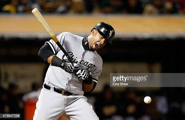 Jose Abreu of the Chicago White Sox reacts after he is hit by a pitch thrown by Fernando Rodriguez of the Oakland Athletics in the seventh inning at...