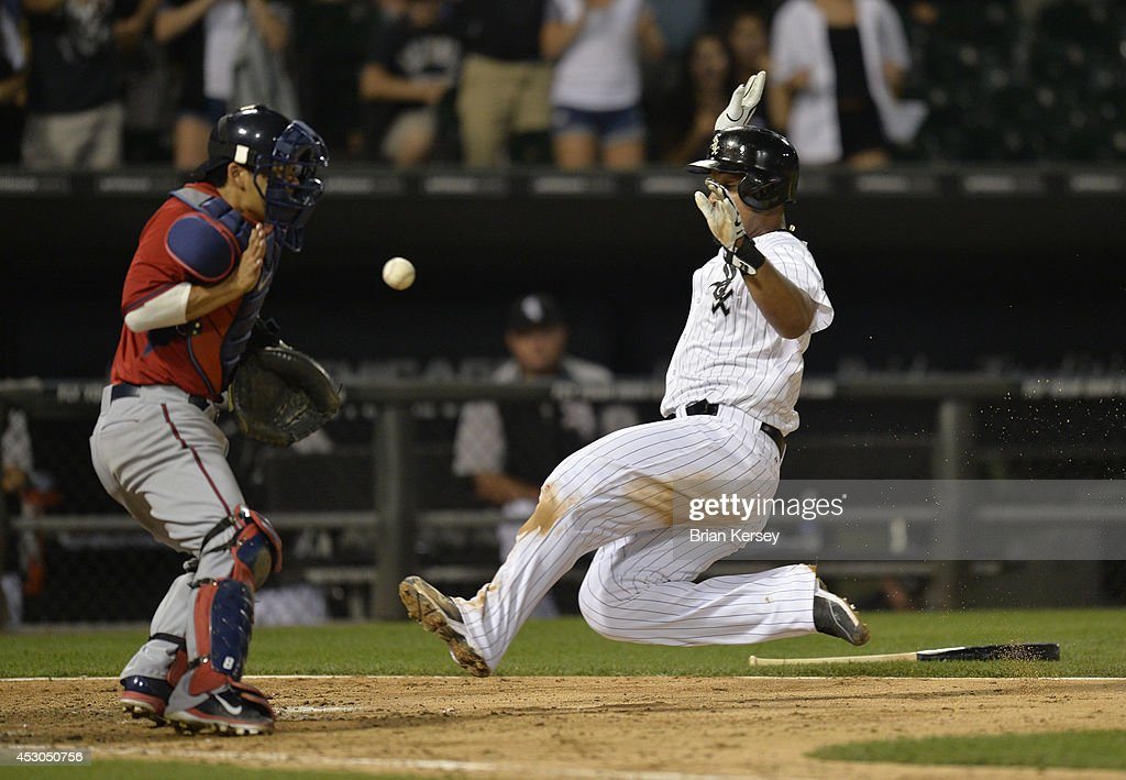 Jose Abreu #79 of the Chicago White Sox (R) scores past catcher <a gi-track='captionPersonalityLinkClicked' href=/galleries/search?phrase=Kurt+Suzuki&family=editorial&specificpeople=682702 ng-click='$event.stopPropagation()'>Kurt Suzuki</a> #8 of the Minnesota Twins on an RBI single hit by Alexei Ramirez during the eighth inning at U.S. Cellular Field on August 1, 2014 in Chicago, Illinois.