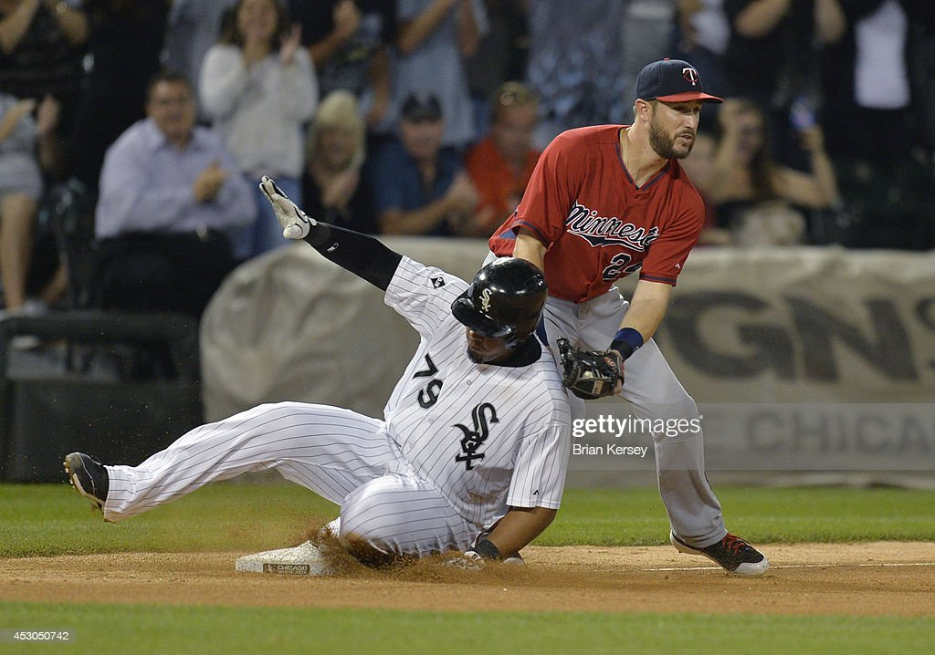 Jose Abreu #79 of the Chicago White Sox slides safely into third base as third baseman <a gi-track='captionPersonalityLinkClicked' href=/galleries/search?phrase=Trevor+Plouffe&family=editorial&specificpeople=5722348 ng-click='$event.stopPropagation()'>Trevor Plouffe</a> #24 of the Minnesota Twins puts on a late tag after Paul Konerko hit an RBI single scoring Adam Eaton during the eighth inning at U.S. Cellular Field on August 1, 2014 in Chicago, Illinois.