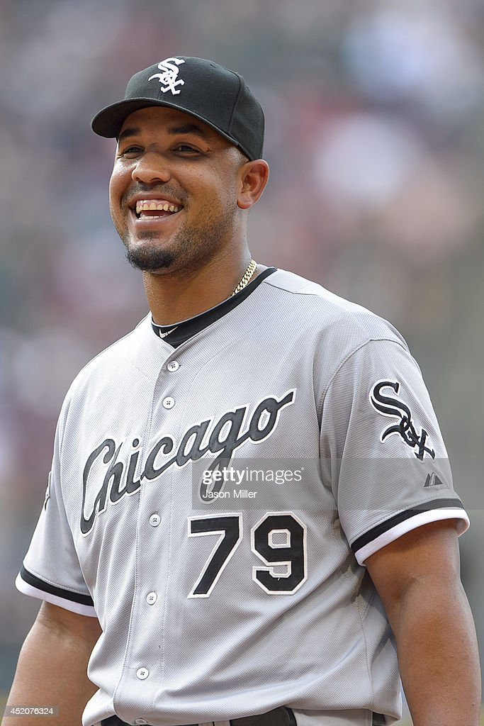 Jose Abreu of the Chicago White Sox talks to his teammates in the dugout during the sixth inning against the Cleveland Indians at Progressive Field...