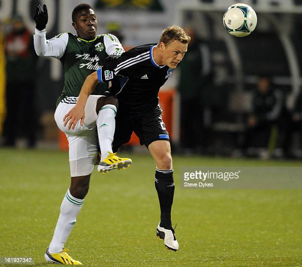 Jose Adolfo Valencia of Portland Timbers tries to get around Ty Harden of San Jose Earthquakes during the second half of the game against the San...