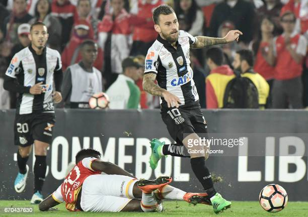 Jose Adolfo Valencia of Santa Fe struggles for the ball with Lucas Lima of Santos during a group stage match between Independiente Santa Fe v Santos...
